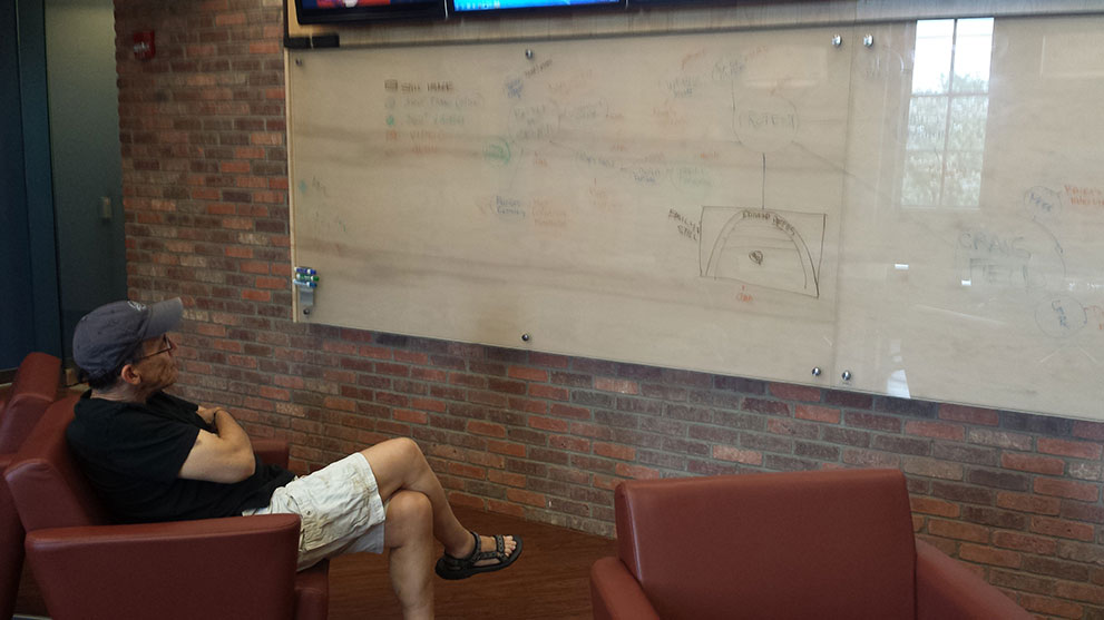 Dr. Joel Beeson pauses to view the Selma virtual reality storyboard in Morgantown, WV on May 15, 2015. This storyboard outlines an early map of the project stories for the VR experience.
