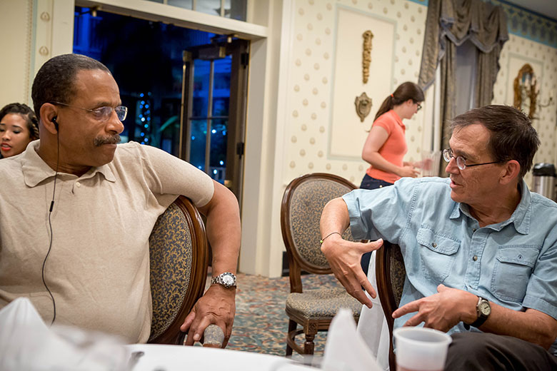 Morgan State University professor Ron Taylor discusses a story with WVU's Joel Beeson during a break working on the Bridging Selma project in Selma, Alabama.