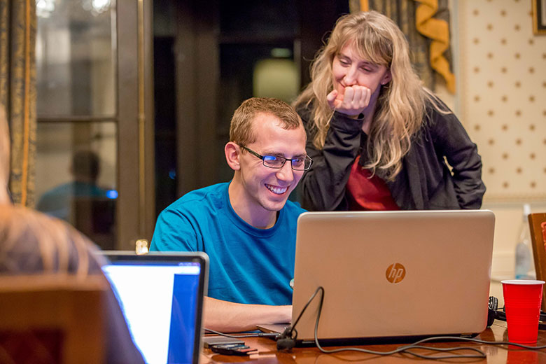 WVU Teaching Assistant Professor Mary Kay McFarland helps WVU student Doyle Maurer edit video at the St. James Hotel in Selma, Alabama while working on the Bridging Selma project.