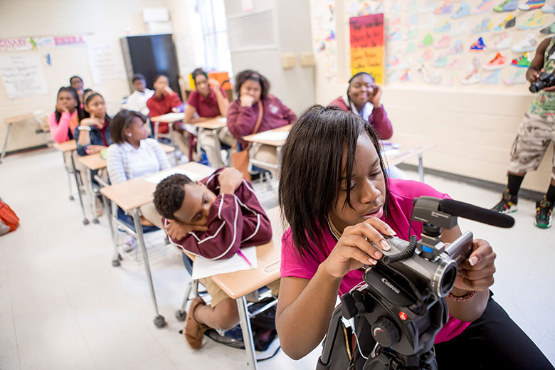 WVU student Shaleah Ingram films in an elementary school classroom while reporting for the Bridging Selma project in Selma, Alabama.